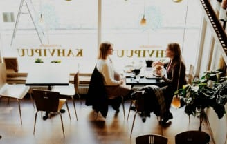 women with coffee talking image