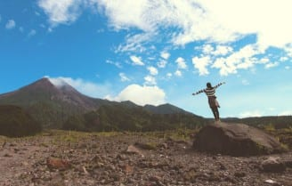 woman looking at sky and mountain image